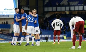 Everton players celebrate while Arsenal players look dejected after the match which Everton won 1-0.