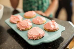 Baking tray with six iced cupcakes.