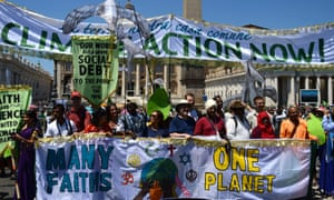 Religious activists at the Vatican call for action on climate change and against world poverty ahead of the climate talks in Paris