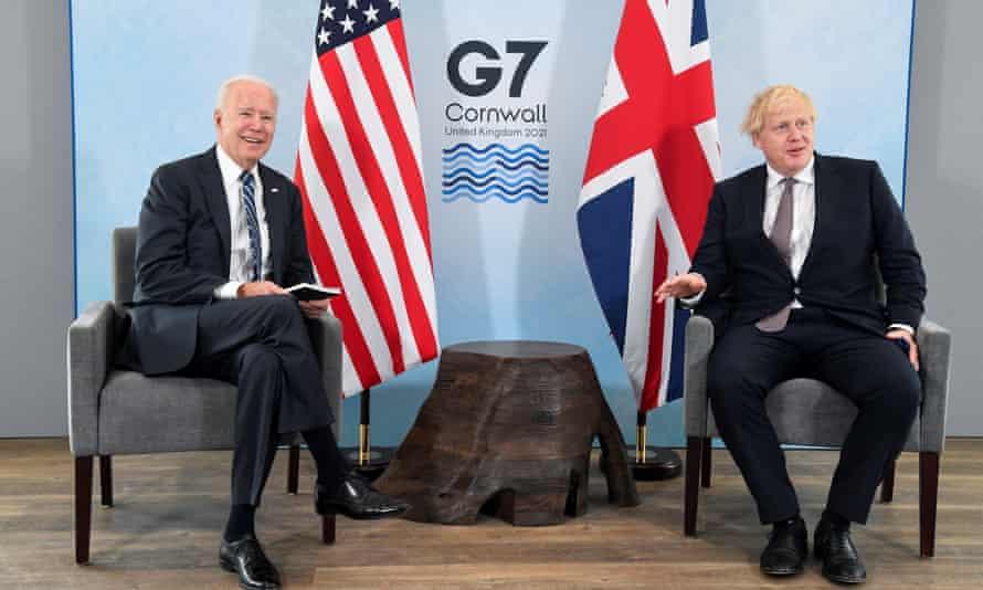 Joe Biden and Boris Johnson and a tree stump