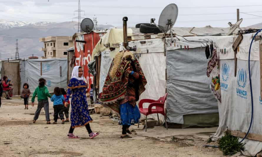Refugees in a camp in Lebanon's Bekaa Valley in March