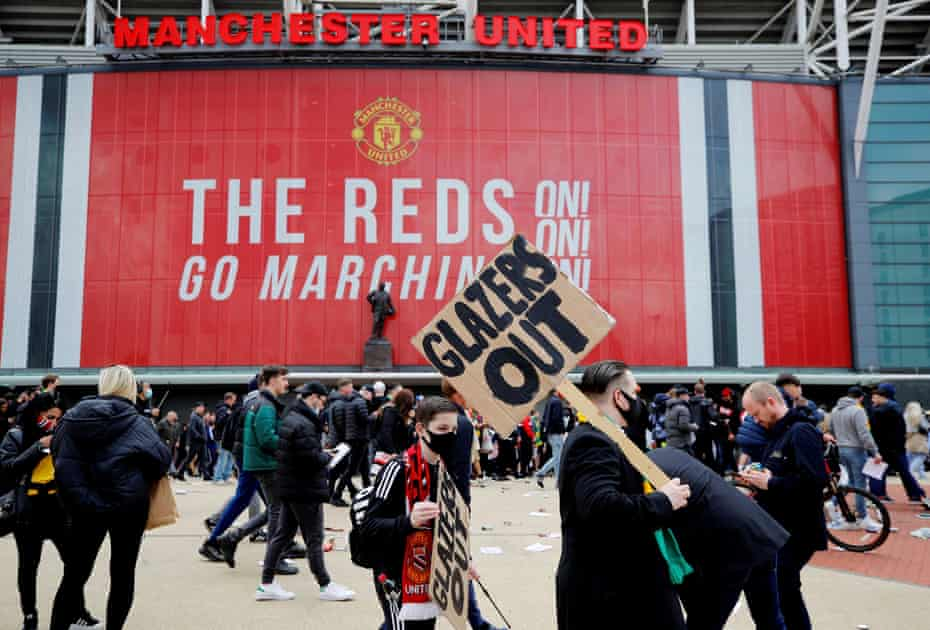 Manchester United fans protest against their owners before the Liverpool match last Sunday.