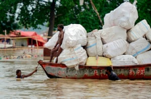 Allahabad, IndiaHindu priests of Sangam move their shelters to drier ground on the banks of the Ganges river, as the water level of the Ganges and Yamuna rivers rises rapidly during monsoon rains