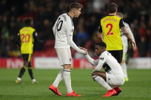 Tom Cairney and Ryan Sessegnon dejected as Fulham are relegated.