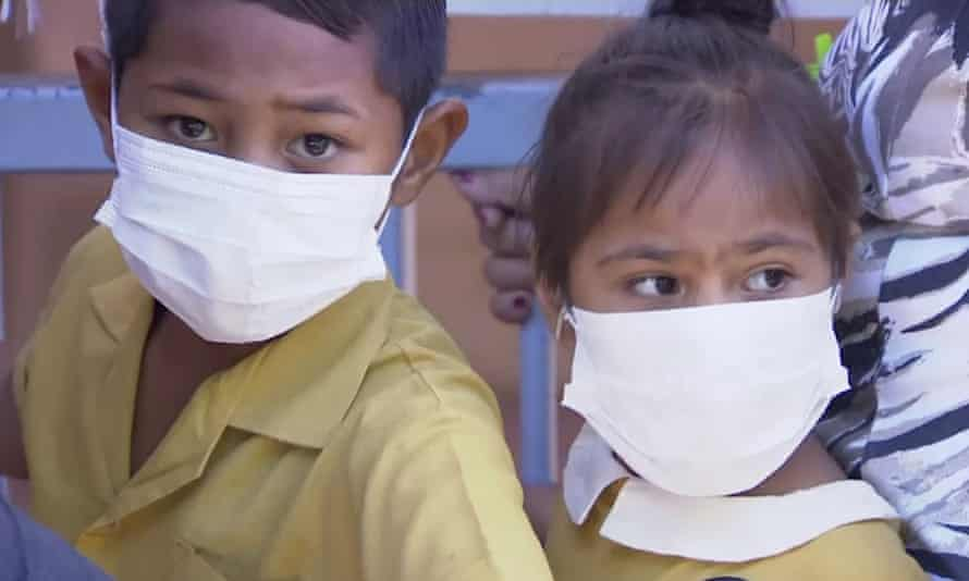 Children wait to get vaccinated at a health clinic in Apia, Samoa.