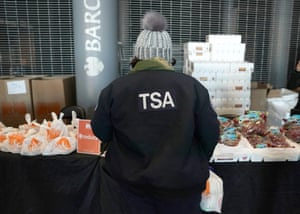A furloughed (TSA) employee at a food bank in Brooklyn during the shutdown.