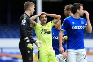 Callum Wilson of Newcastle United looks dejected after Everton goalkeeper Jordan Pickford saved his header.