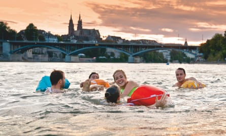 A group of male and female swimmers in the Rhine River, Basel, Switzerland.