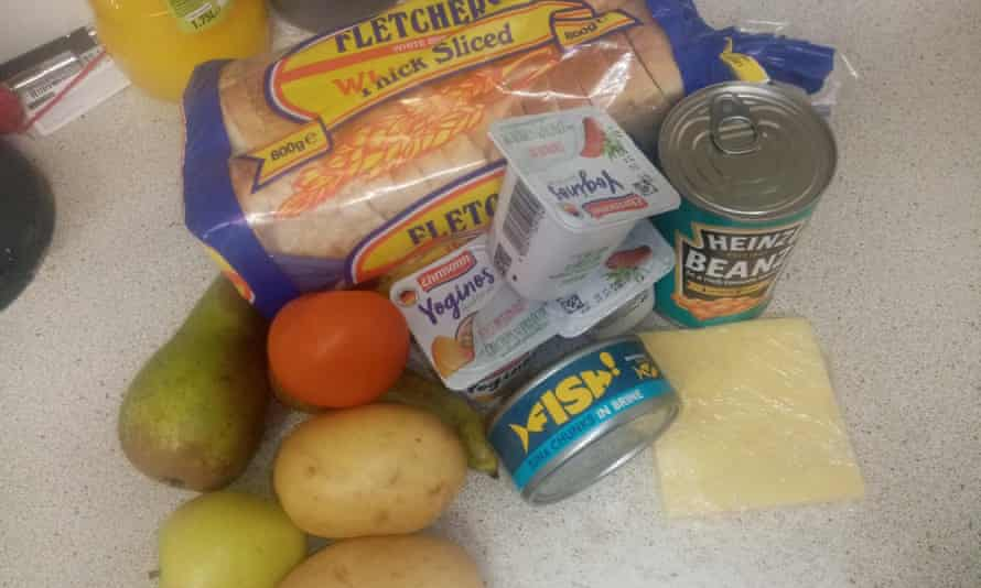 The food package received by a resident in Redcar, North Yorkshire, for her youngest child. Intended to last a week, it contained a loaf of bread, three yoghurts, a tin of beans, tuna, two potatoes, four pieces of fruit and two slices of cheese.