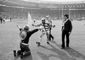 Nicky Kiss of Wigan (holding flag) celebrates after their 28-24 victory over Hull in the 1985 Rugby League Challenge Cup final at Wembley Stadium.