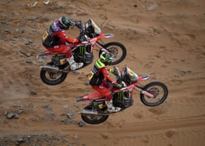 Ricky Brabec (no 15) and Kevin Benavides both get airborne as they power their Hondas during the stage