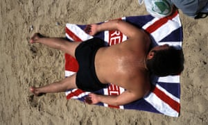 A British visitor enjoys the sol y playa (sun and beach) in Ibiza. Britons are the largest single group of tourists to Spain.