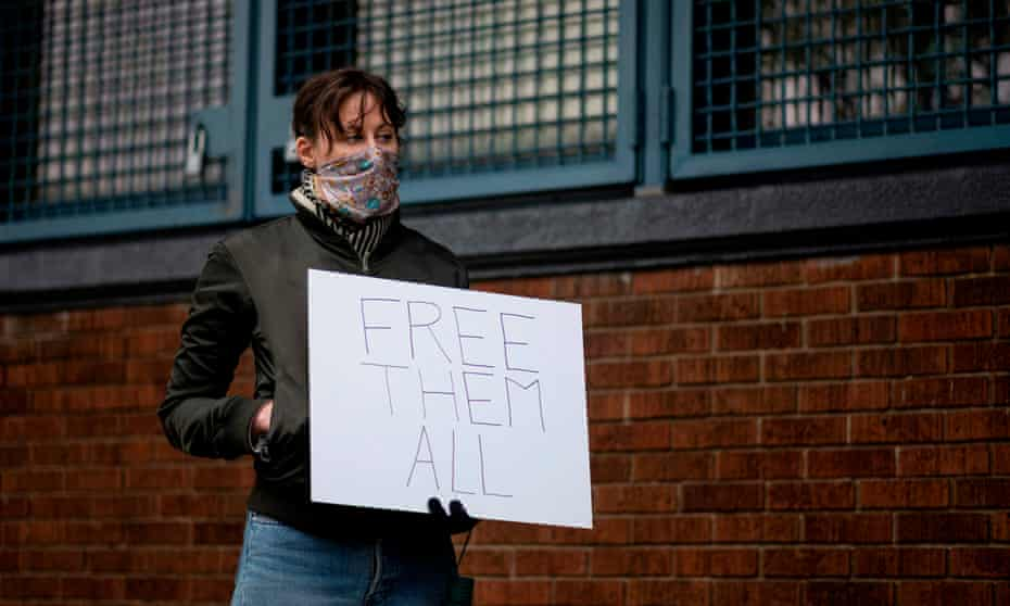 A woman takes part in a vigil outside Queensboro correctional facility in New York City on 23 April.