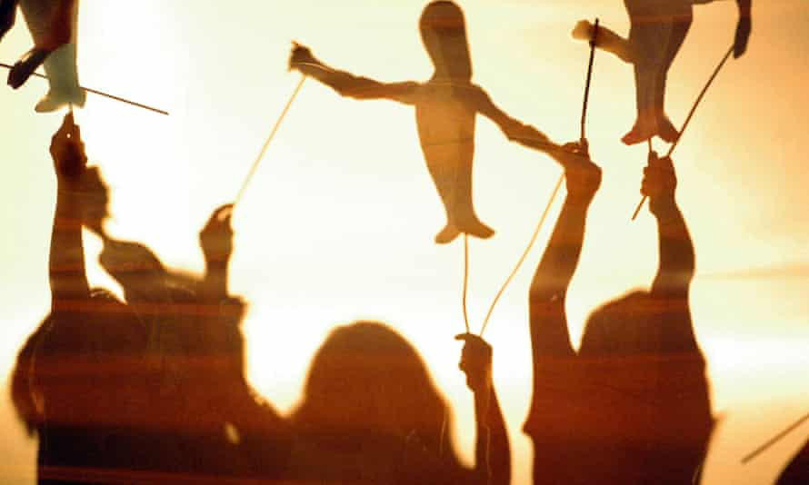 silhouettes of children playing with puppets