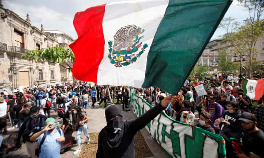 Hundreds of demonstrators march in Guadalajara, Jalisco, Mexico, at the weekend in protest over the death of Giovanni López at the hands of the police.