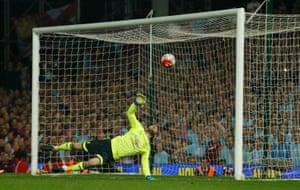 David De Gea is unable to prevent Reid's header crossing the line.