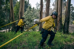Recruit Uribe pulls hose during a wildland training exercise in the San Leandro hills. After the devastating 1991 firestorm in the neighboring Oakland hills, recruits are now rigorously trained on more extensive wildland firefighting equipment
