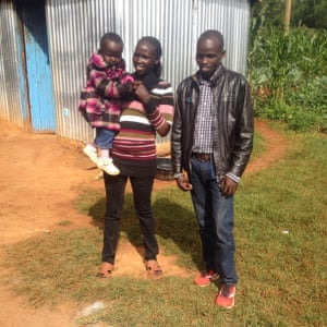 Beatrice outside her house with her young daughter and Japhet, Iten, Kenya