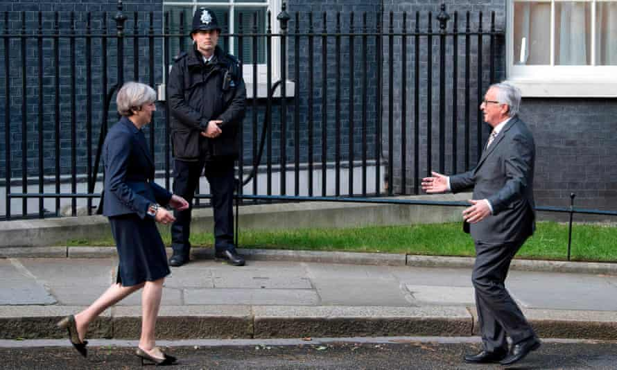 May greets Juncker outside No 10 last month.