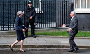 Theresa May greeting Jean-Claude Juncker outside No 10