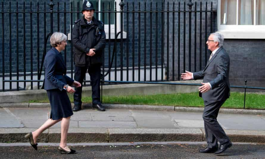 Theresa May greets Jean-Claude Juncker outside 10 Downing Street in April 2017.