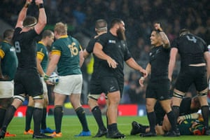 The final whistle goes and New Zealand players celebrate