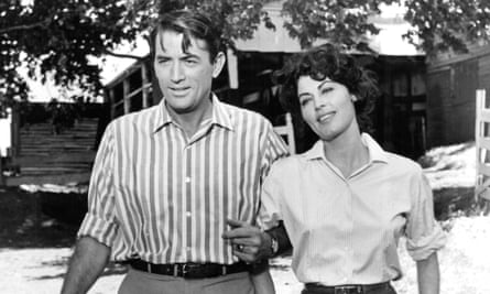 Gregory Peck walks with Ava Gardner in a scene from the 1959 film On The Beach.