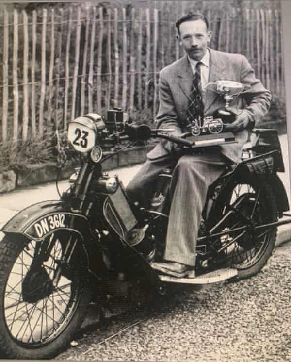Tom Moore with his motorcycle racing trophies.