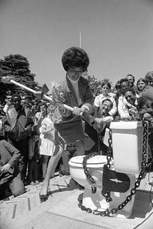 Assemblywoman March Fong breaks a porcelain potty with a sledgehammer on the steps of the Capitol in Sacramento, California, April 26, 1969.