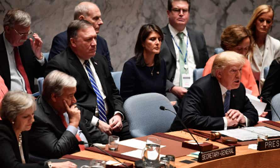 Donald Trump chairs a session of the UN security council flanked by the secretary general, António Guterres and the British prime minister, Theresa May, and backed by US officials.