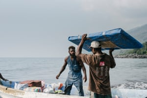 A small boat is packed with possessions from communities in West Ambae, Vanuatu, forced to evacuate due to heavy ashfall and increased volanic activity.