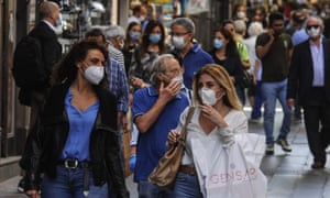 People in face masks in Naples city centre as it emerges from lockdown