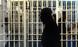 Silhouette of person inside prison
