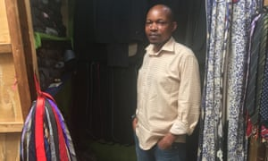 Rutayisire Ibrahim, a trader at Biryogo market in Kigali, sells secondhand men's trousers, suits and ties.