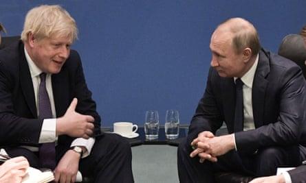 Boris Johnson meets Vladimir Putin at a peace summit on Libya in Berlin, January 2020