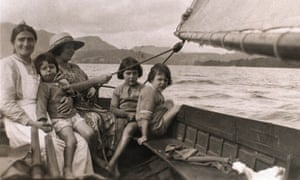 Mavis Guzelian (née Altounyan), the inspiration for the character Titty in Arthur Ransome's Swallows and Amazons, on the lap of a nanny while boating with her sisters Taqui (left) and Susie on Coniston Lake in the early 1920s.