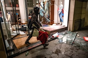 Barcelona, Spain: A looter leaves a shop with a mannequin during riots in response to the imprisonment of rapper Pablo Hasel