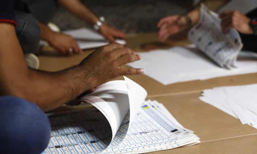 Election officials count ballots in Baghdad