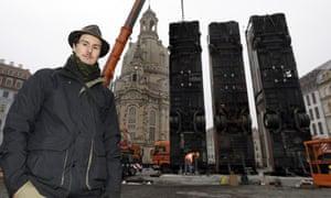 Manaf Halbouni in front of his artwork in Dresden