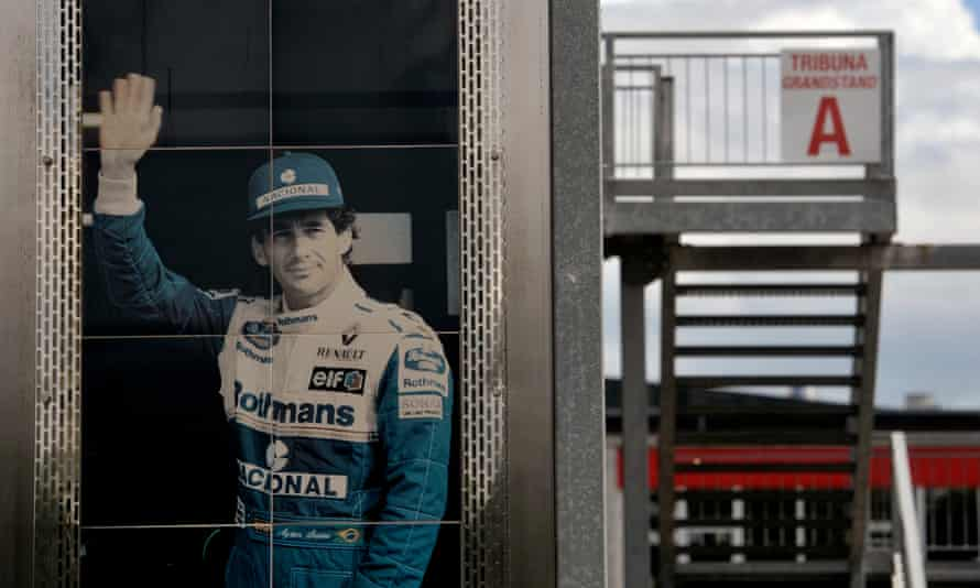 A giant poster of Ayrton Senna hangs from the tribute dedicated to him at Imola.