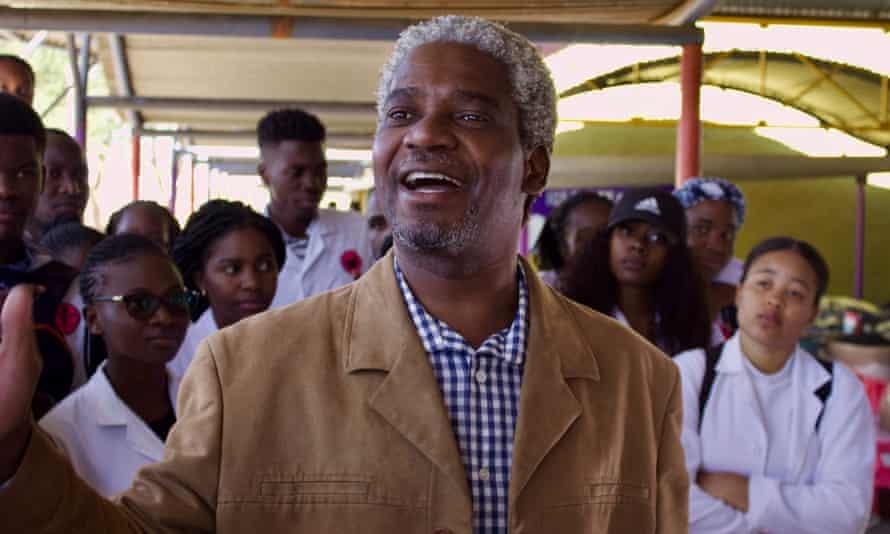 Vetjaera Haakuria talks to his students at the market in Windhoek.