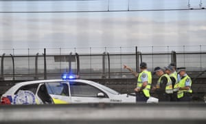 Police block off lanes on the Sydney Harbour Bridge after a man climbed the structure at 4.30am on Wednesday.