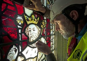 York, UK: The Conservation manager Nick Teed removes part of a stained glass window in York Minster Cathedral's south quire aisle during the first phase of work to protect the glass, which dates from the late 1300s