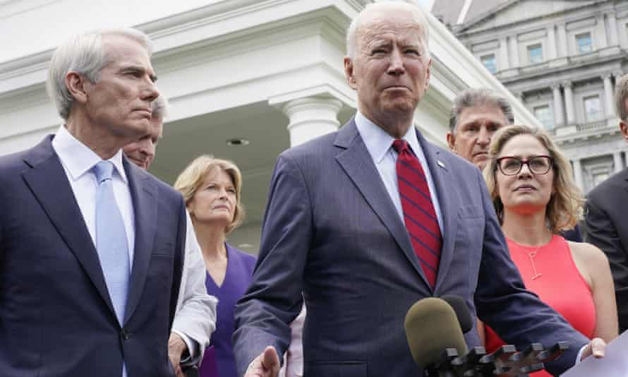Rob Portman, left, listens to Joe Biden on Thursday.