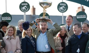 Tiger Roll's owner Michael O'Leary savours the victory as trainer Gordon Elliott, right, looks on.