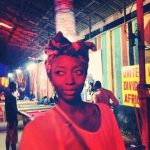 A clubber called Zainab poses for a portrait at The New Afrika Shrine, a popular nightspot in the Ikeja area of Lagos, Nigeria.