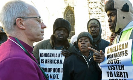 The archbishop of Canterbury Justin Welby speaks to pro-LGBT protesters in 2016.