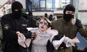 Military police detain a woman at an opposition protest in Minsk
