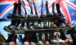 Boots are pictured on a market in Camden Town in London.