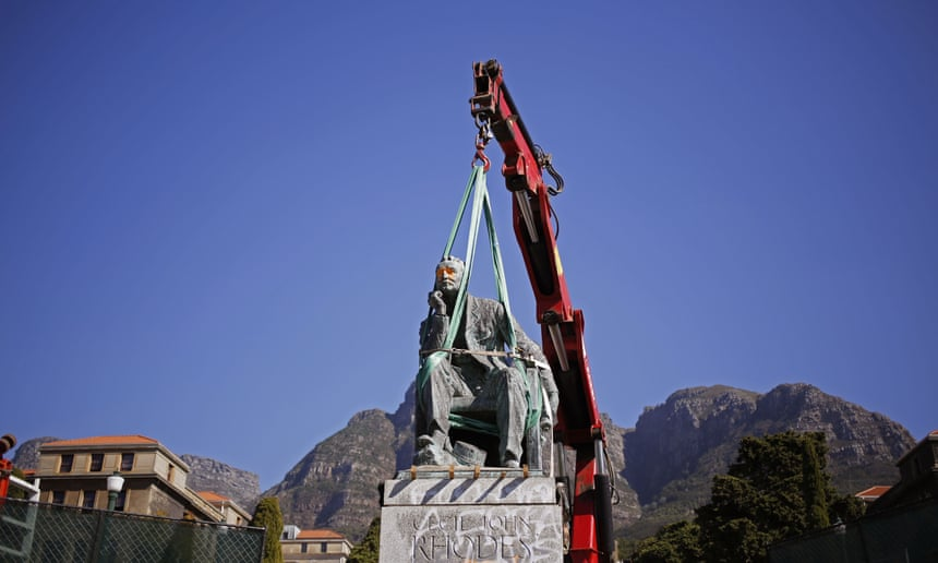A crane prepares to remove the statue of Cecil Rhodes from its plinth at the University of Cape Town, in April.